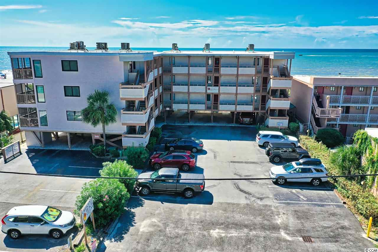 Welcome home to this gorgeous 2 bed/2 bath unit in Crescent Beach Villas.  Owners have spared no expense in updates--Wood-look flooring, new central AC unit with transferable warranty, granite counters in kitchen, upgraded cabinets with pull-out drawers, custom drapes with remote controls, and much more.  Tastefully furnished and ready for you to move right in!  In-unit washer/dryer for convenience.  Enjoy your morning coffee or evening cocktail on the balcony and see and hear the beautiful Atlantic ocean!  Relax by the community pool or head to the beach to soak up some sun.  This unit has never been rented but has great rental potential.  Whether you are looking for a permanent residence, a vacation get-away or an investment property, you won't want to miss this one...schedule your showing today!