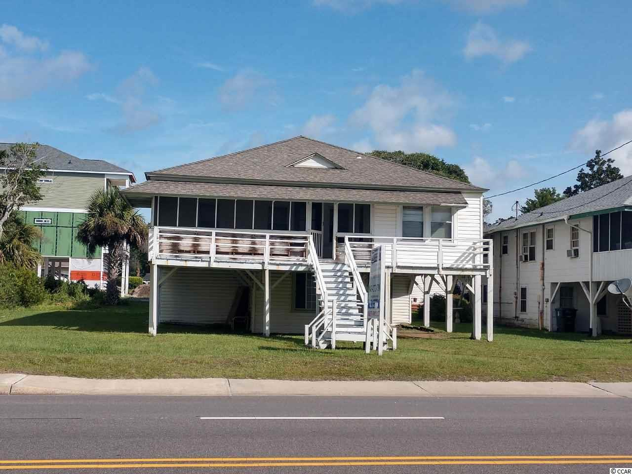 This is  second row property.  House need a lot of work.  It is a charming old beach house, built in 40's and has been in one family the entire time. It has pine paneled walls and pine floors throughout.  Located on a lot and a half with 75' of Ocean Blvd. frontage and 108' deep.  Ideal re-development site for a duplex.  Great location, close to Main Street and directly across the street from the Atlantic ocean.  Square footage is approximate and not guaranteed.  Buyer is responsible for verification.