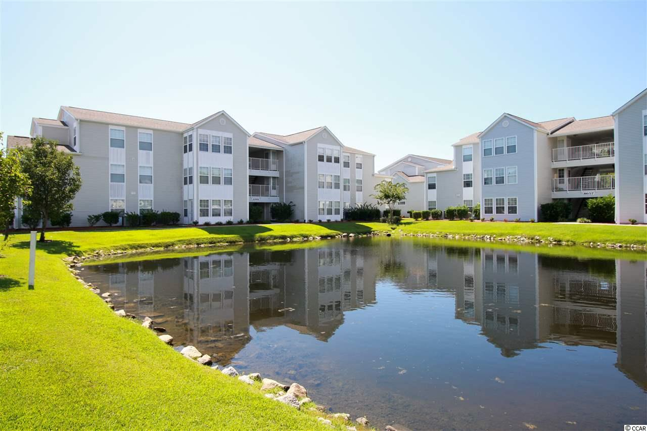 Great 2 Bedroom Condo with Lake View. Only Approximately 1.5 miles from the Ocean in Surfside Beach. This 3rd floor Condo has an Open Floorplan with lots of Natural Light.  Master Bedroom has a Great Walk-In Closet & Barn Door To Master Bath. Complex is Conveniently Located near Hospitals, Shopping, and Restaurants. Enjoy the Lake View from the Carolina Room.  Southbridge has a Neighborhood Pool and a Basketball Court. Most Furnishings Can Be Included & Sold Separately. Measurements & Sq. Footage Approximate.