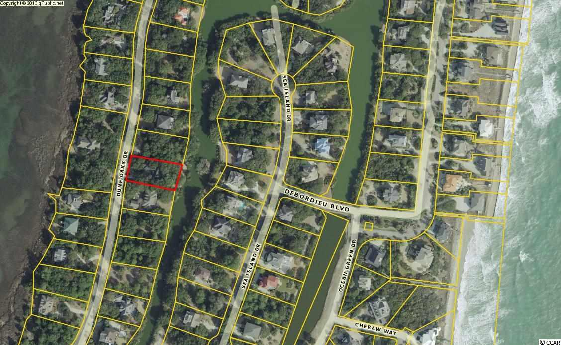 Heavily wooded homesite near the beach in the coveted Dune Oaks area. Gated community with Private Golf, Tennis, & Beach Clubs, nature preserve, and boat ramp with creek & ocean access.
