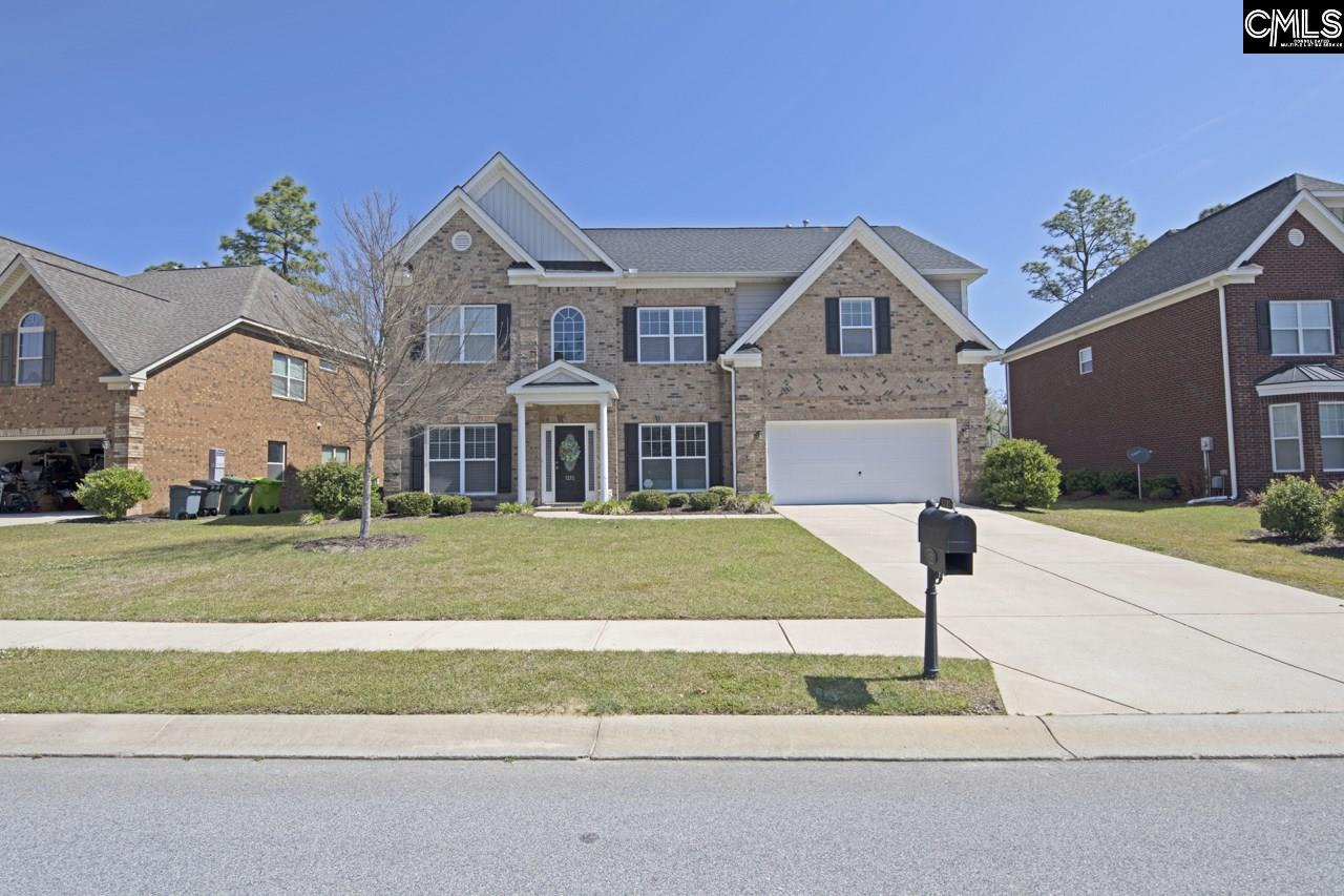 Well maintained 5 bedroom, 4 bath brick home located in Lake Carolina. Walk-in closets, molding, hardwoods, fenced in yard, and in-law suite downstairs. This home has a lot to offer. This home is also zoned for Blythewood Middle and High School.