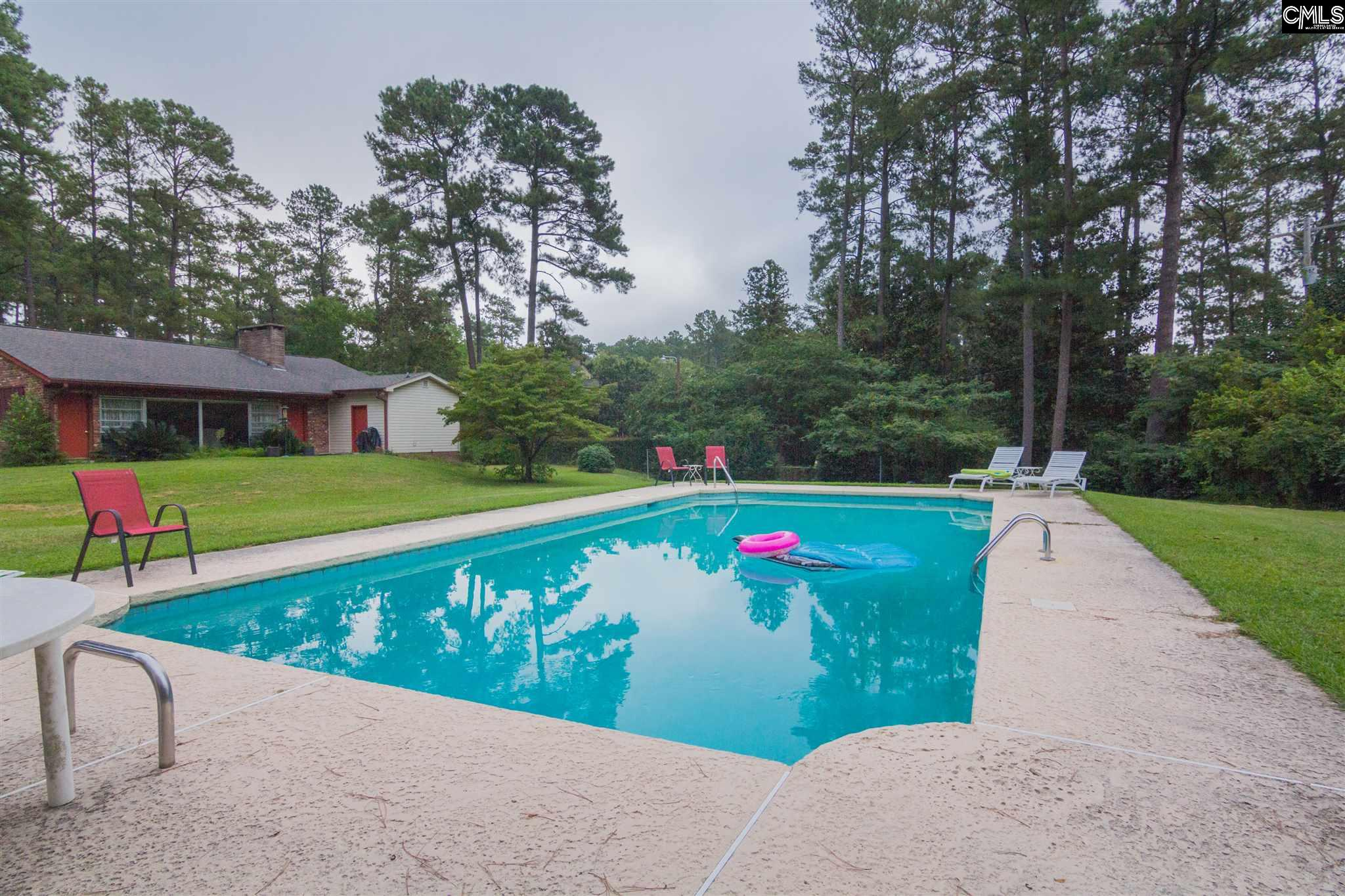 Incredible Location.  One of the best streets in Columbia.  Solid built home that needs some renovations.  Rooms are large and spacious.  Open Floor Plan with an enormous fireplace.   Gleaming Hardwood Floors. Huge flat lot. (almost 1 Acre)  Gunite Pool.