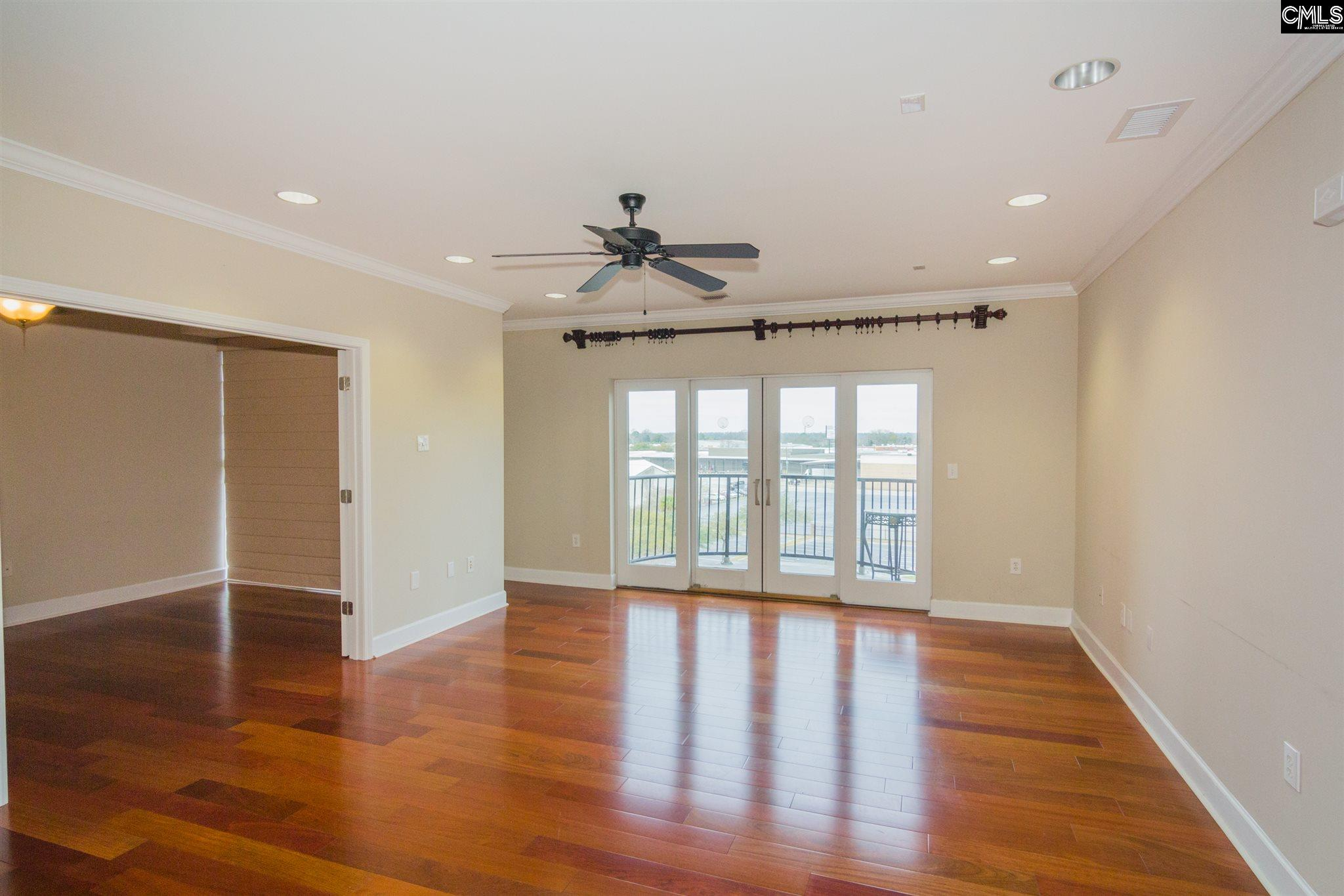 Stunning 2 bedroom 1.5 bath game day unit! Gleaming hardwood floors throughout, granite kitchen countertops with stainless steel appliances and a wet bar. Balcony over looking the city side and Carolina Walk Park. Comes with 2 parking garage spaces. Located just minutes from Downtown, USC, Midlands Tech and major interstates like I-77.