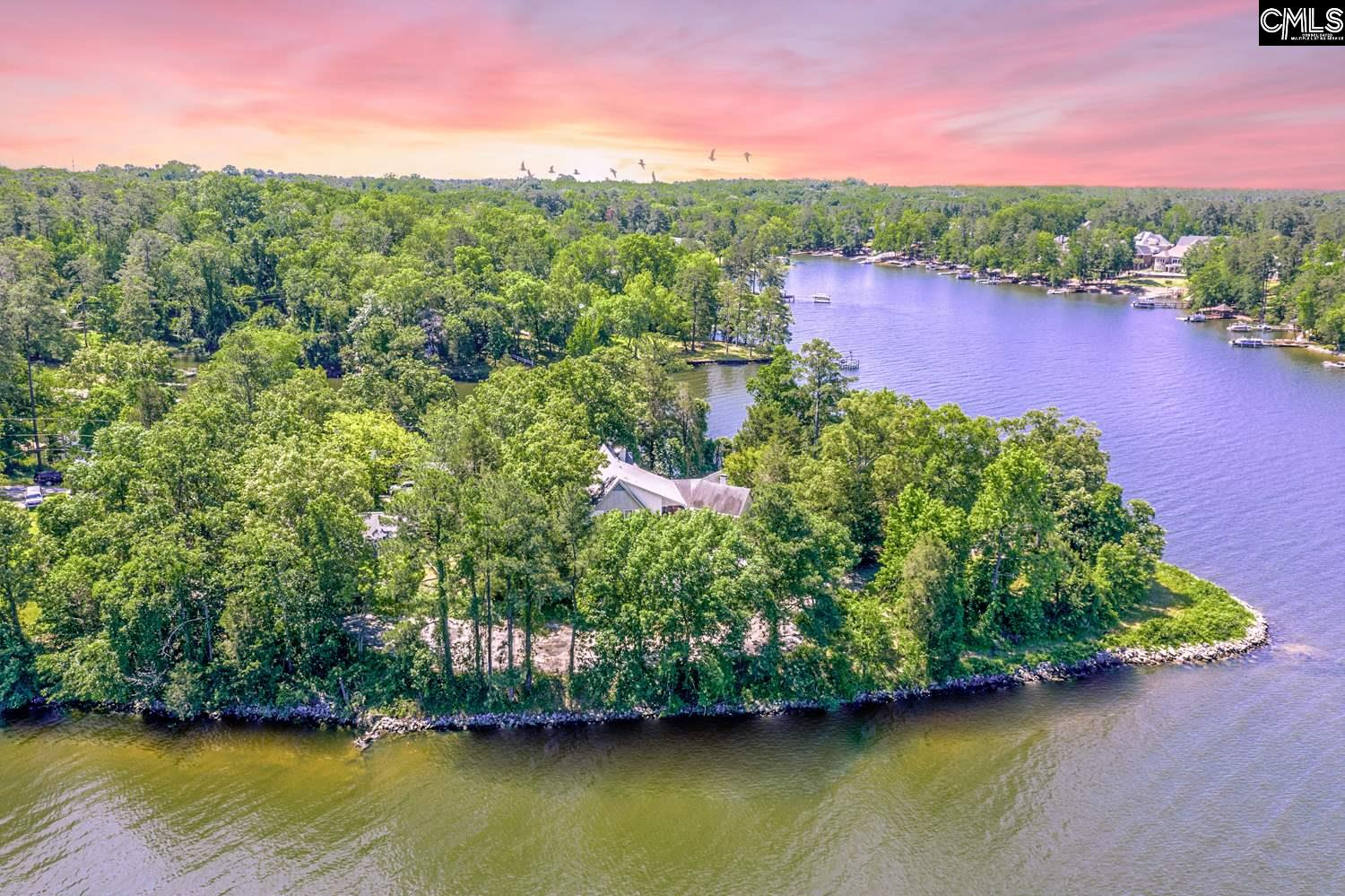 Spectacular lakefront property.  This is a rare opportunity to purchase a large lot on Lake Murray that is close in, with panoramic views and just under 1000 feet of water frontage.  Property already has rip rap on water frontage, boat ramp and existing dock.  There is an older home, garage and outbuildings on the property but the value is in the land itself.  This is a beautiful, private peninsula with lush vegetation.    Please do NOT try to access the property by water or private drive without listing agent present.