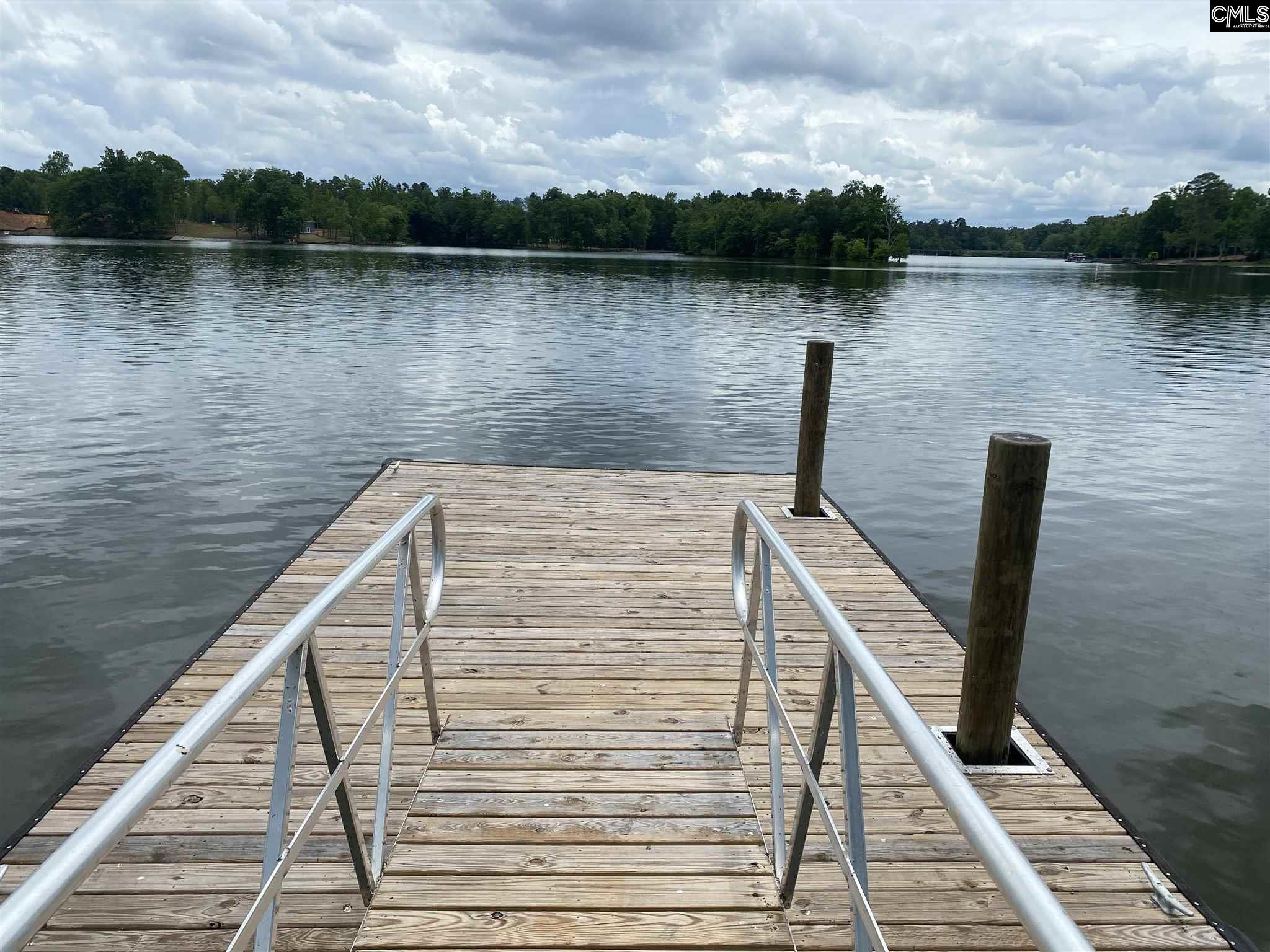 Beautiful lake lot with boat ramp and private dock in place. Big Cove with great views!  The lot is cleared and ready to build on.  DHEC approved for a 2 BR conventional system. New survey being completed.  Light restrictions in place to include 600 square-foot minimum.