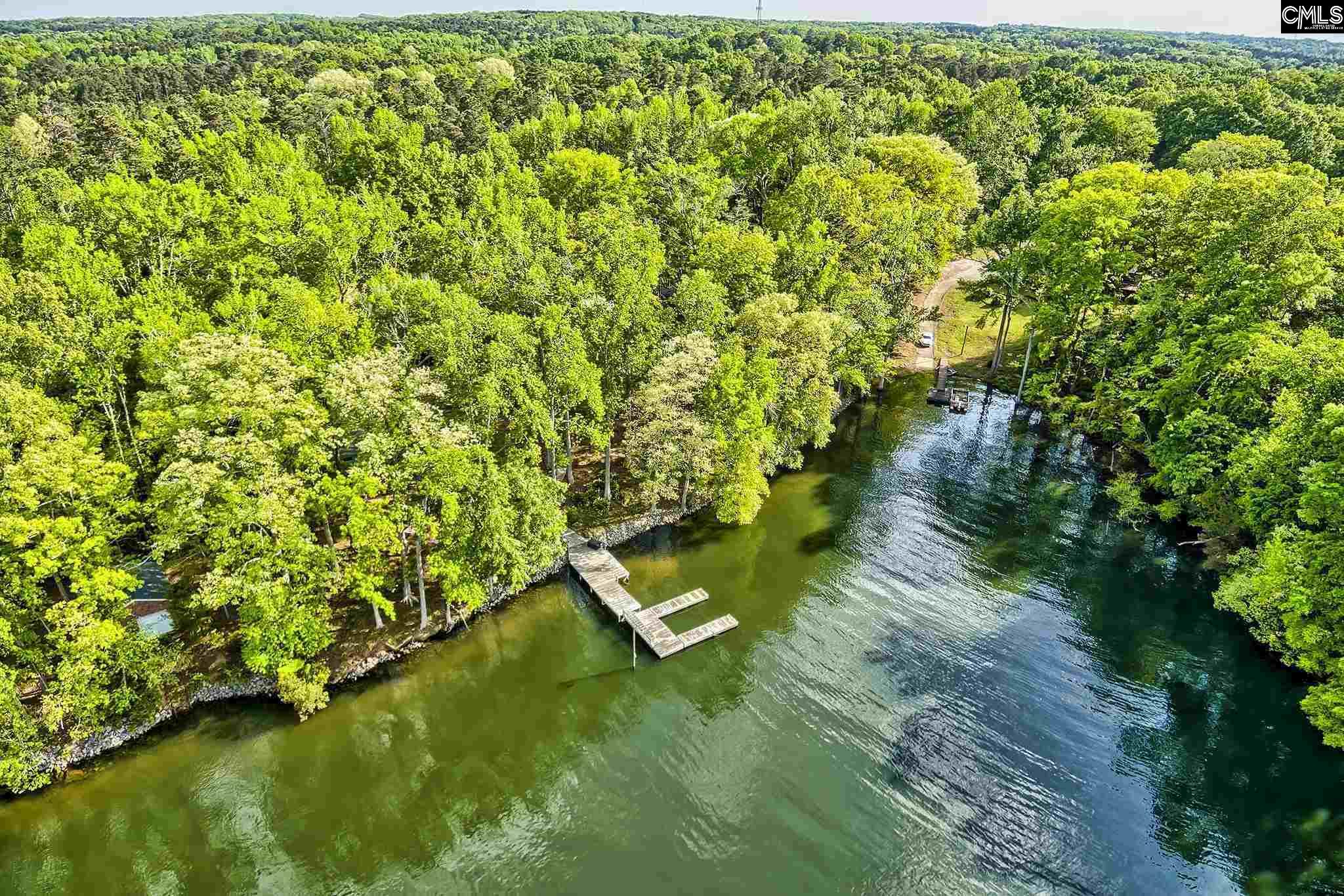 Close in 1.16 acre lot on Lake Murray with 131 feet of water frontage.  Private dock approved!  Gated entrance!