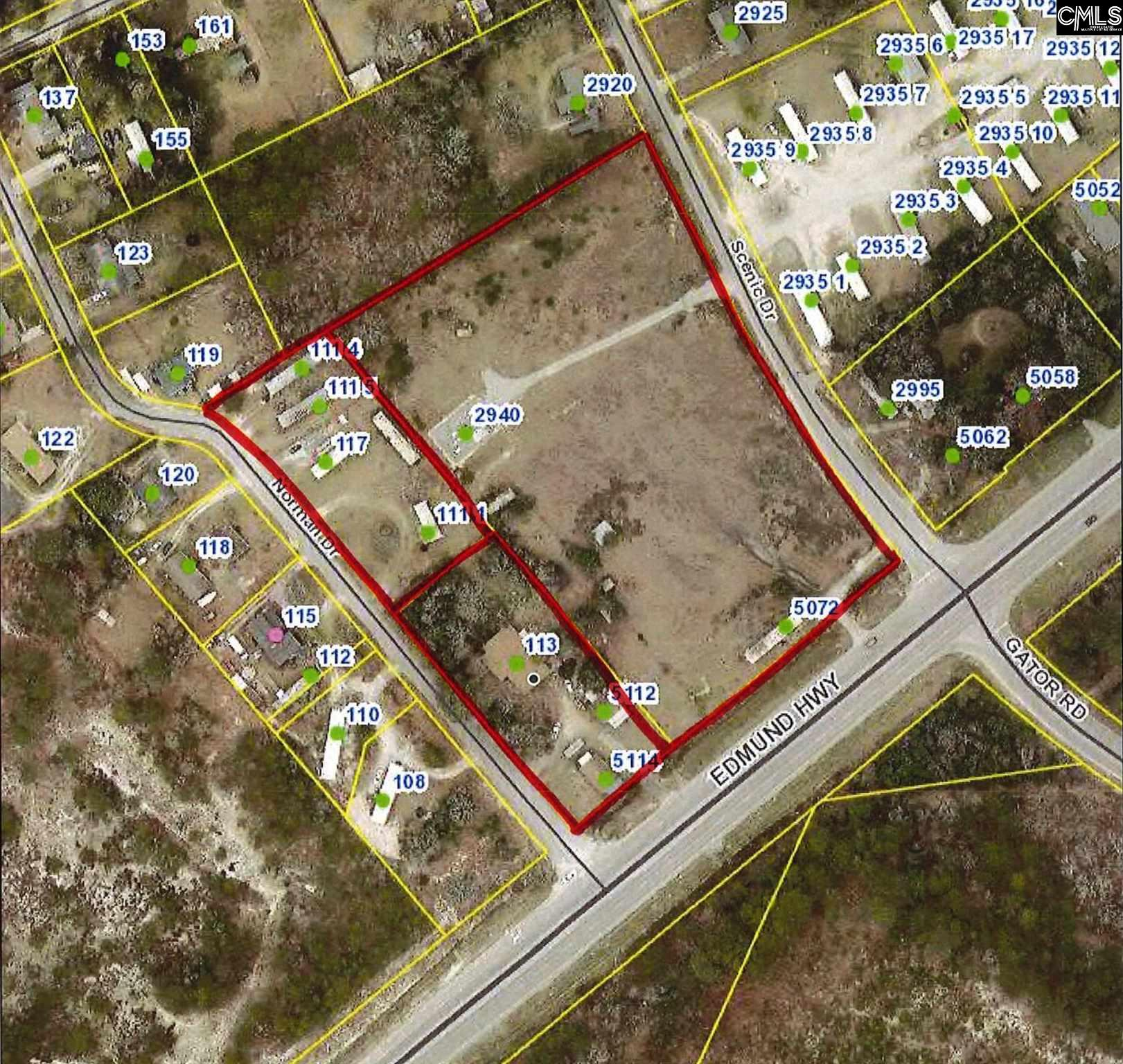 +/- 6.71 acres with a 1,200 sq. ft building that has a septic tank, a 24'x34' shed and a 4 bed, 3 bath house. It also has 4 mobile homes on the property bringing in $1,300 a month plus 1 lot rental that brings in $100 a month. All structures are being sold as-is and where-is. This property can be found on two hard corners on Edmund Hwy and has a cellphone tower on it. The owner does not own the lease on the cellphone tower. TMS# 007720-03-005 and 007720-03-011 included in sale.