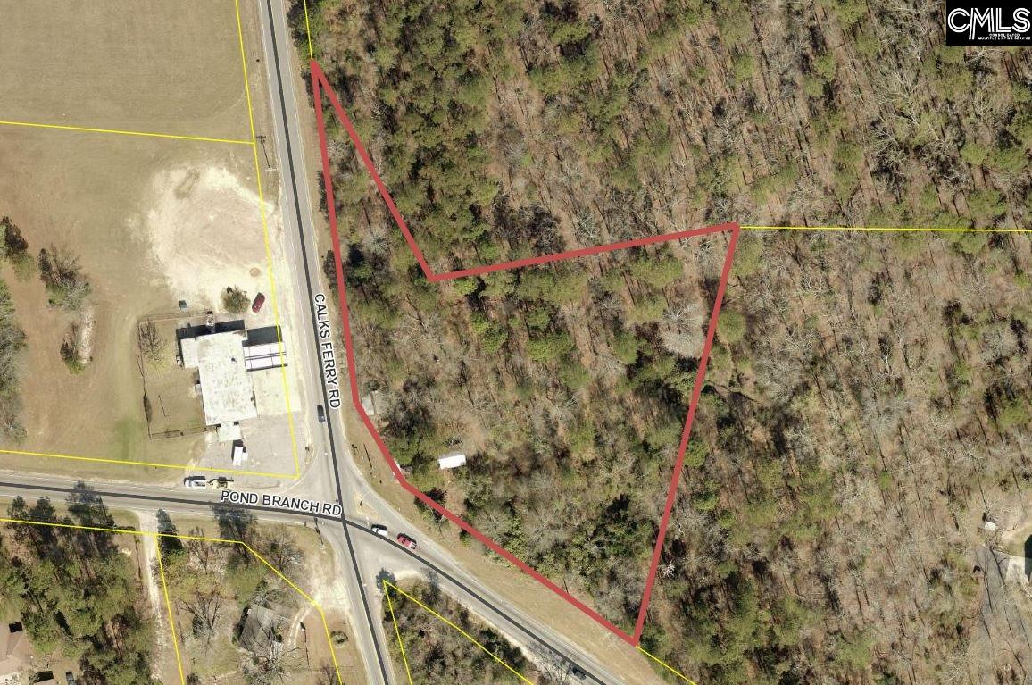 +/- 2.35 Prime commercial acres on the busy corner of Pond Branch Road and Caulks Ferry Road.  3200 VPD Calks Ferry Road and 4900 VPD Pond Branch Road.  Public water available with JMWSC.  +/- 700 ft of road frontage. Close proximity to Interstate 20, Downtown Lexington and the rapidly growing Red Bank and Pelion areas.