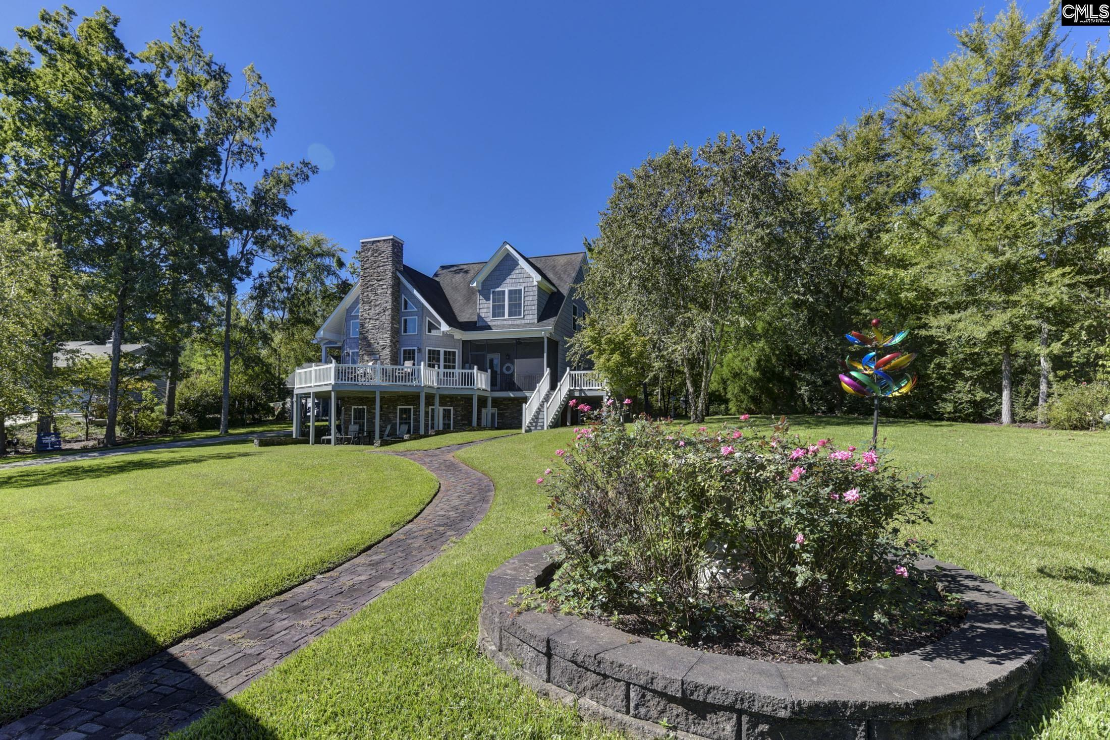 Welcome home!  This beautiful 2.5 story home on Lake Murray is waiting for you!  It includes a large backyard in a stunning cove.  When you walk down to the water, you'll find a large private covered dock.  Come see the home that makes everyday a vacation!