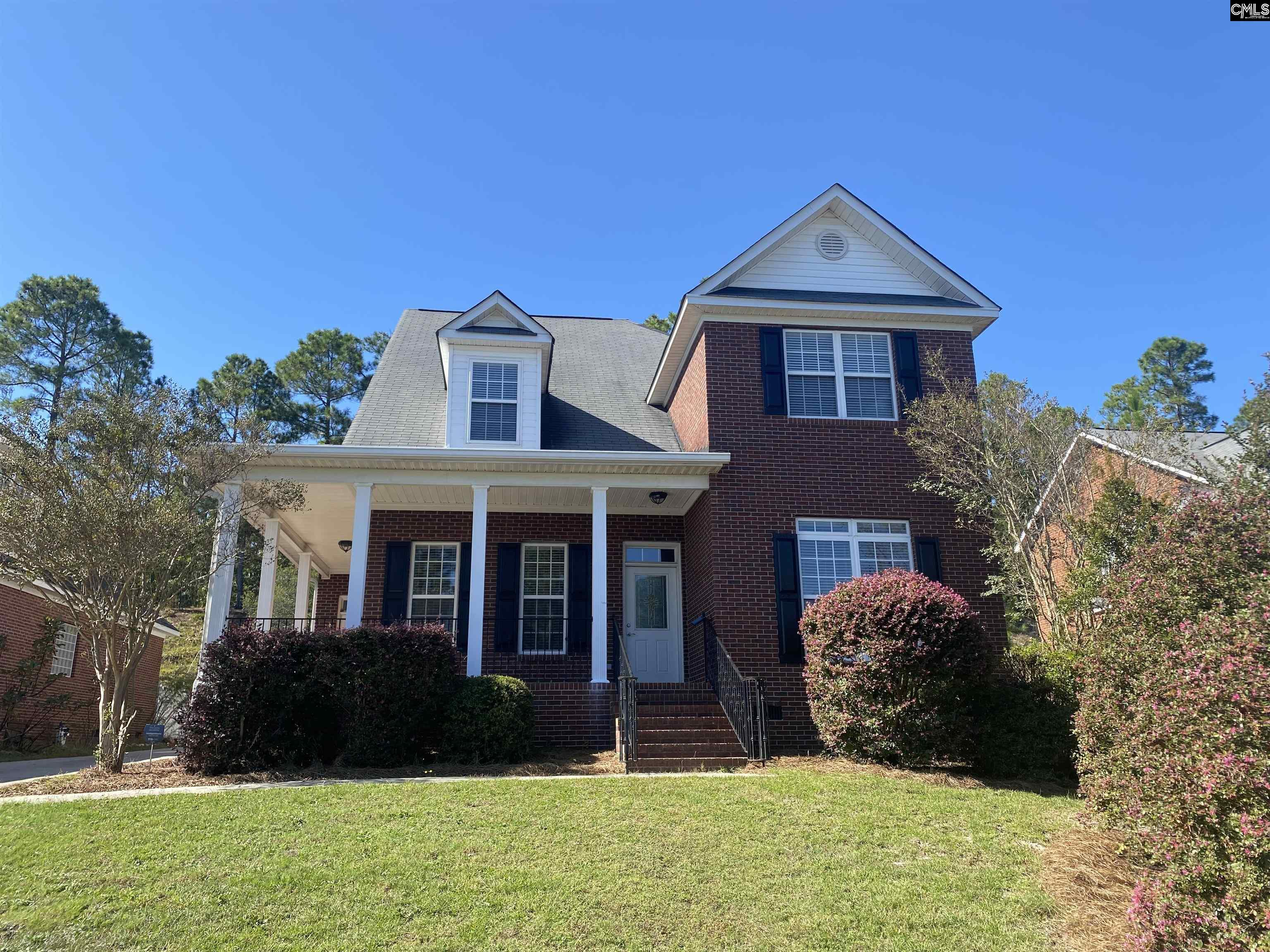 Large all-brick home with two car garage in terrific location!! New carpet and paint! Master bedroom on main floor. Formal dining room with hardwoods. Screened-in back porch. Wrap around front porch with tile floors. Beautiful home!!