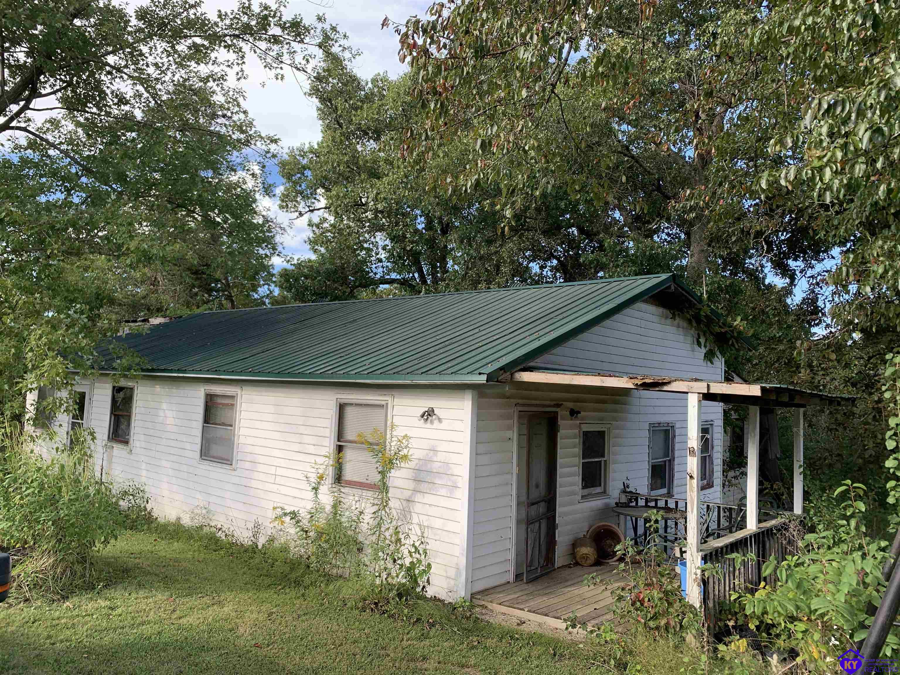 INVESTORS! Here is your opportunity to snag a 2,400+ sq foot ranch, on over 3.5 acres for less than $16.60 a square foot! This home has city water, septic and is almost 75% fenced, perfect for a flip. Take a look today!!