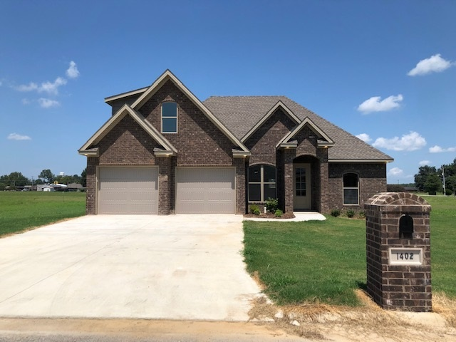 New Construction - All Complete! Interior features a split floor plan with three bedrooms downstairs with a separate bonus room upstairs, two bathrooms, open kitchen with dining area, and living room with exposed beam. All brick exterior with covered back porch. Two car garage.