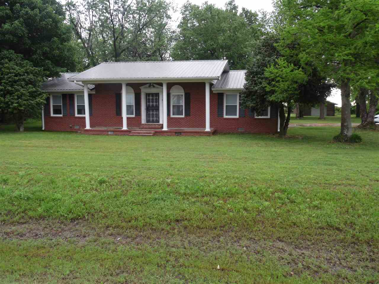 Newly renovated 1784 sq ft 2 bed, 2 bath home on HWY 18 in Monette on 1.5 acres with a 20x30 shop building with garage door. Appraised for $130000 over a year ago.   All renovations took place in 2017-2018: New windows, new metal roof, new HVAC, new gutters and soffit, new vinyl plank flooring and tile throughout except did not change carpet in kids room, new toilets, new sink in master, new vanity area with sink in master bedroom/closet area, all new lighting/ceiling fans inside and outside, p