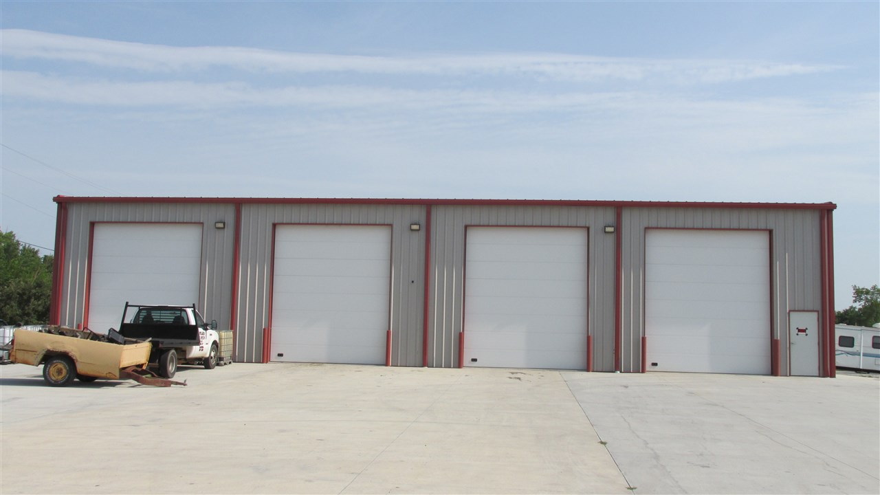 Excellent opportunity, 5400 square foot Automotive Repair/Tire Shop, near new building and equipment.  Includes 4 bays with 18' x 14' doors, radiant floor heating system, 10x10 office, 18' x 9' waiting room, 2 rest rooms and storage loft.  15000 lb hoist, balancer, tire changer, bead breaker & pump, spreader & base, 2 sets Green Truck tire irons, Calcivac pump assembly and 2 American Indian 80 gallon 5 HP air compressors.