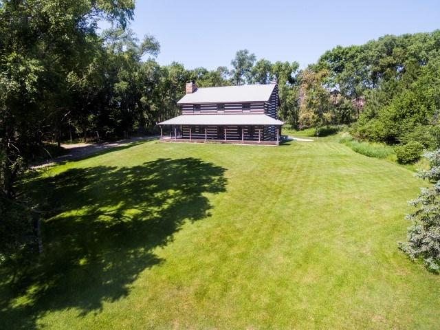 """There are so many unique things about this property that you must make time to see it in person! Large home with a """"retreat feeling"""" to it. Stone floors, wood beams, open concept, extra large kitchen, and wrap around porch are just a few features. This home sits on an excluded lot just a little under 10 acres. It has a pond that would be great for fishing, large metal shed for all your """"toys"""" and a barn equipped with a half bath, electricity and heat/air. Lots of open space for outdoor activities. Make your appointment today!"""