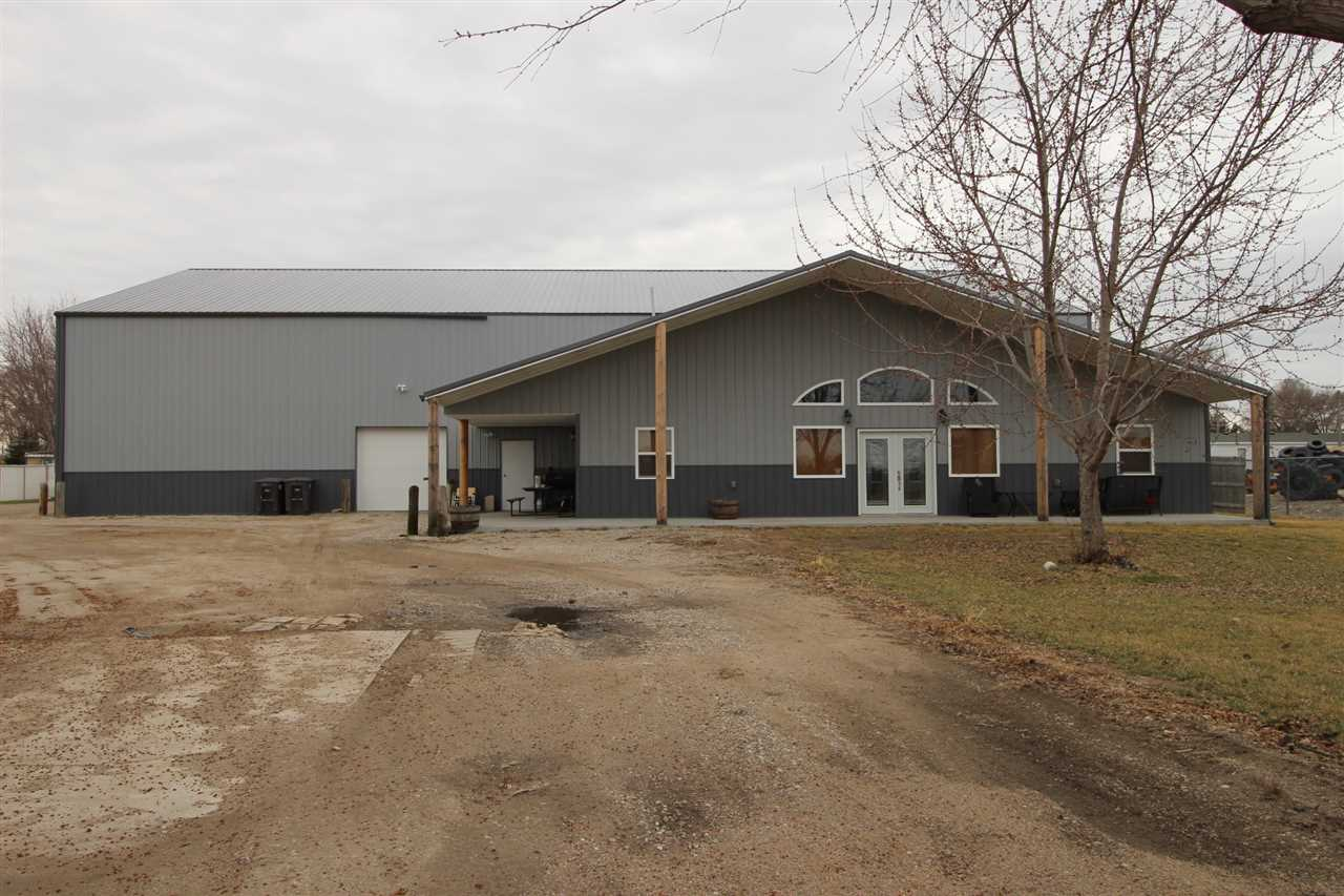 7000 sq ft Warehouse. 2000 sq feet finished, 5000 sq ft warehouse. New stainless appliances, floor heat & heat pump, large utility room, office, like new! Built 2013. Warehouse 5000 sq ft heated, completely insulated, sheet rocked, wired, 3 overhead doors, storage in loft area, 14-16 ft ceilings. Additional 1500 sq ft - Enclosed loft area in warehouse.