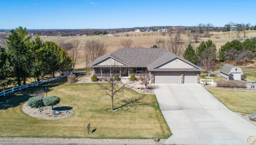 This is a beautiful custom 1 owner, 5 bedroom, 3 full and 2 half bath home - sitting on 1 acre in a quiet addition just outside of the city limits.  Open concept floor plan - new kitchen granite 2018, large walk-in pantry - main floor master suite updated 2017.  3 car attached garage & 2 car tandem garage with shop underneath top garage with forced air heat & 220 wired for welder.  Great space!! 12x16 Utility shed.  100 gallon propane tank for fireplace & gas grill.   Unbelievable landscaping - including a 2000 gallon pond with waterfall!