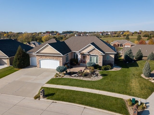 """If you are considering building a custom home, check this home out first! You cannot build this home for this price today. This custom built """"Street of Dreams"""" home offers several amenities from the 10' and 12' ceilings on the main floor, 10' ceilings in the basement, open floor plan, lots of cabinets and butler's pantry to the main floor laundry with generous cupboards and counter space and a drop zone area when you walk in from the garage. The large master bedroom features a double coffered ceiling and custom lighting. You will appreciate the soaker tub with bubble jets, two separate cherry wood vanities, and the multi-jet tiled walk in shower in the master bathroom. The walkout  basement boasts a large family room, a wet bar, two bedrooms that share Jack and Jill bathrooms, and two storage rooms. The partially covered deck is perfect for outdoor entertaining. YOU MUST SEE THIS HOME FOR YOURSELF!! Pictures do not do it justice!"""