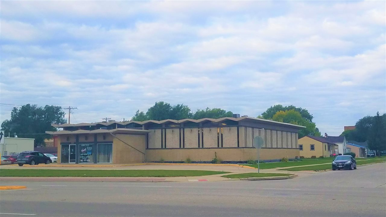 Here is your opportunity to own 13,000 +- square feet of office space on 13th street/Highway 81 in Norfolk Ne. If you need space this has it with over 35 offices, 9 restrooms, multiple conference rooms/meeting spaces and over 40 parking spaces. This property would be perfect for one organization or it can very easily be split into shared space due to its configuration around the central open-air courtyard. The other option is to purchase the building and lot for future development on this very busy corridor. Much of the internal space has been modernized and a little TLC to the remainder would require limited work. The price of $38.00 per square foot is very competitive in the current market so don't miss out on your chance to own a significant amount of space.