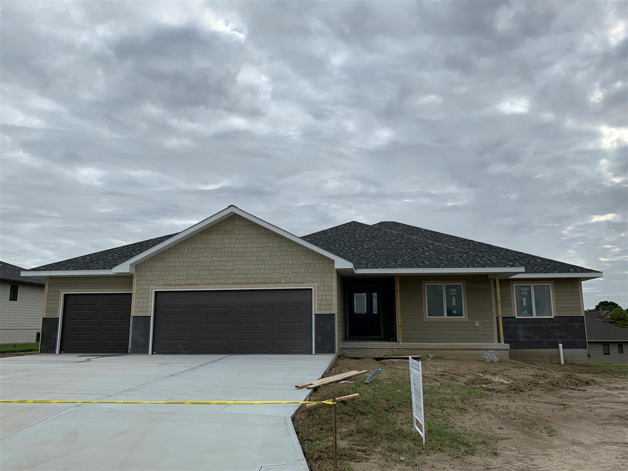 Brand new craftsman ranch style home in Wyndham Hills Subdivision. Open floor plan with corner fireplace. Nice pantry in kitchen. Large laundry with drop station for backpacks, etc. Large deck with stairs to big backyard. Finished walk out lower level.