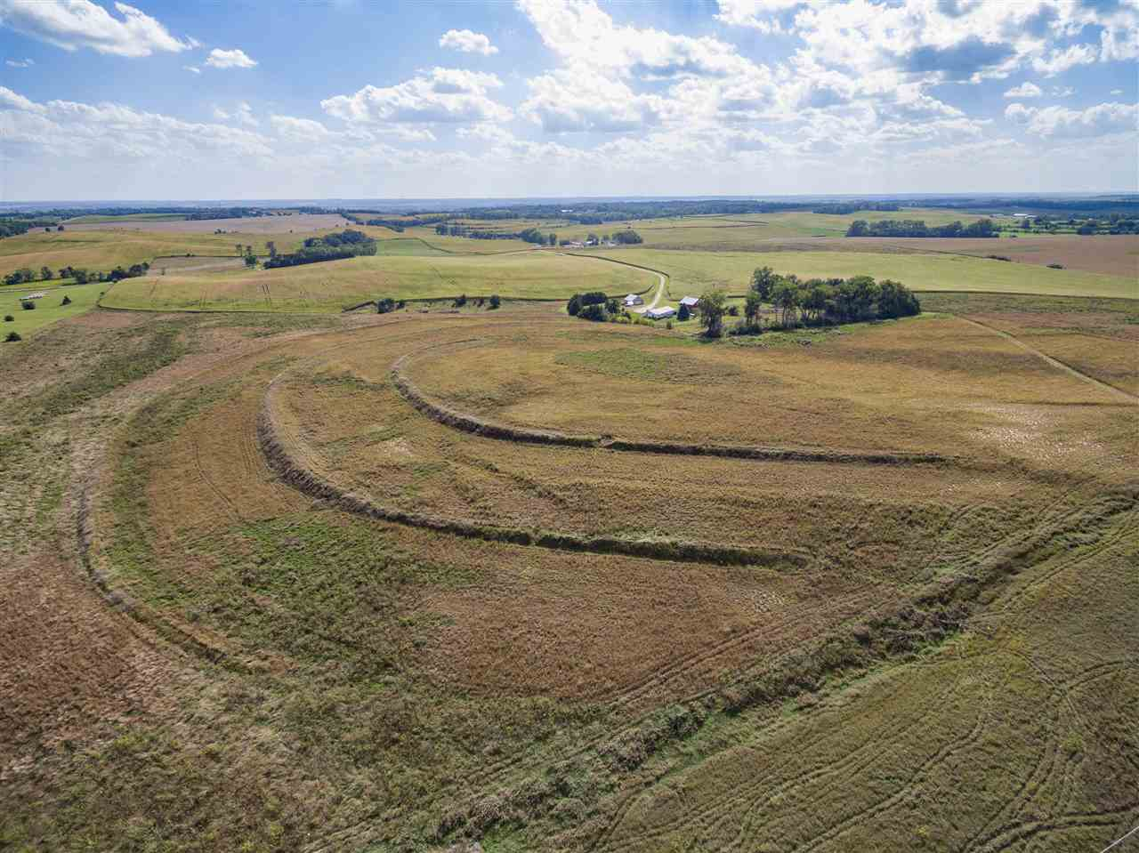 Attention: Investors, Hunters, Developers. 153 +- acres of Row Crop and Conservation Reserve Program mix located a mile from the city limits of Norfolk Ne. The property consists of 147+- tillable acres of with 70+- row crop and 77+- acres of CRP under contract until 2025 and 2028. The CRP contracts generate $198 and $202 per acre. The dryland crop ground lease runs year to year and has been generating $240 per acre. The CRP is abundant and is home to upland game and deer. The rolling hills create a perfect opportunity for tower blinds. A dry pond could be reinvigorated for fishing or waterfowl habitat. With its close location to Norfolk and its rolling topography the south end of this property would be perfect for residential acreage development. Own your dream acreage or hunting paradise while letting the lease and CRP income pay for it. Call today for additional information or to tour the property.