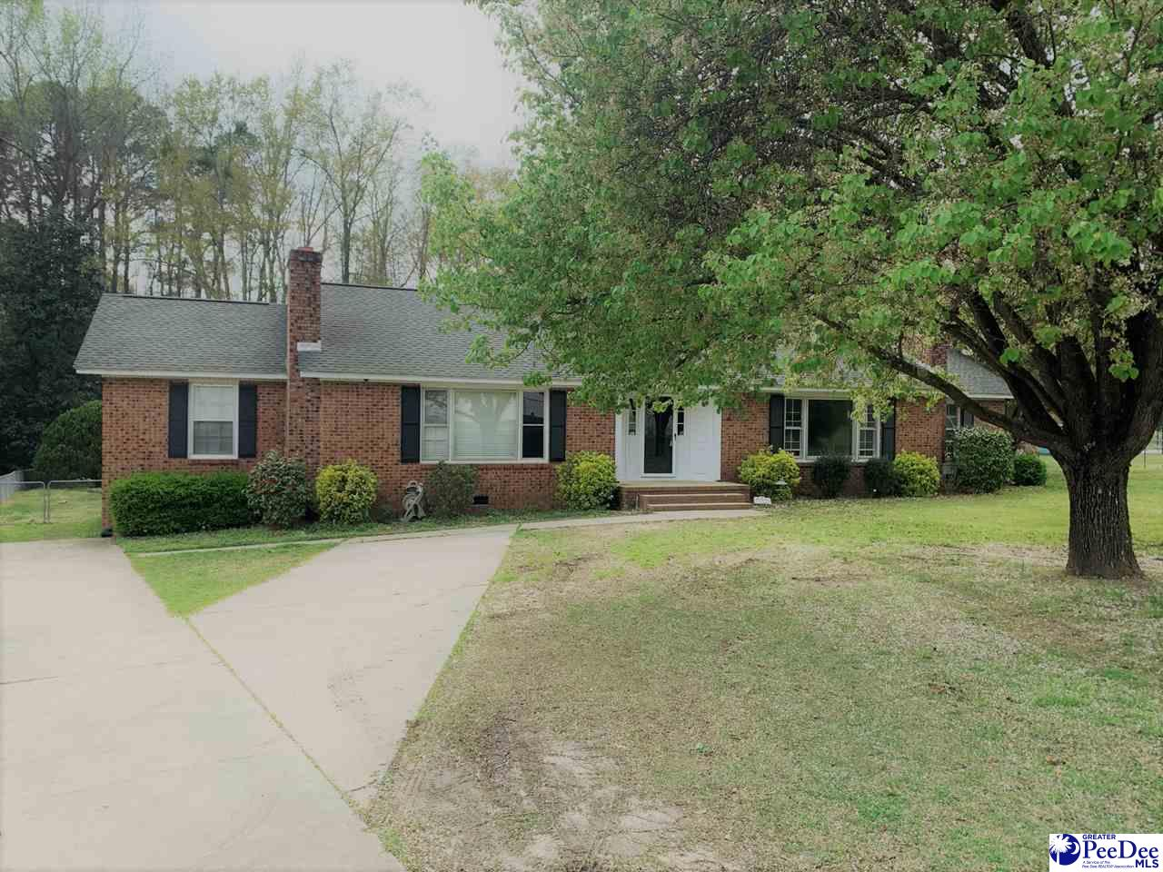 Move in ready ranch style four bedroom brick home located in established neighborhood.  This home has been completely renovated with new laminate flooring throughout.  Fenced in back yard and covered patio area. Kitchen has two pantries for extra storage. Call today to view this home!