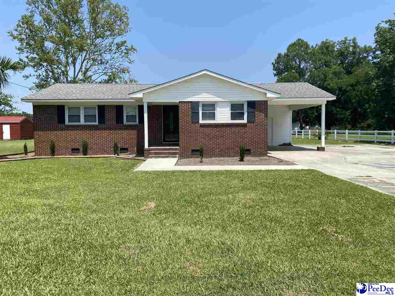 Completely renovated home looking for its new owner! Beautiful landscaped yards.   Home features 1,097 sq ft, 3 bedrooms and 1 bath, granite counter tops, and tile floor in bathroom.  2 storage areas, 1 car attached carport, and concrete drive.   Call today to view this home.
