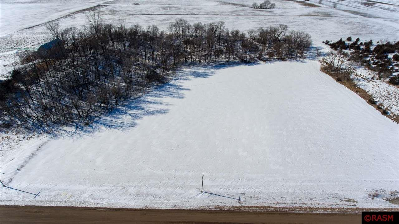 5.03 Acres premier land to build your dream home. A beautiful terrain and a gorgeous chunk of woods! Across from Le Sueur Country Club. Just minutes from town.