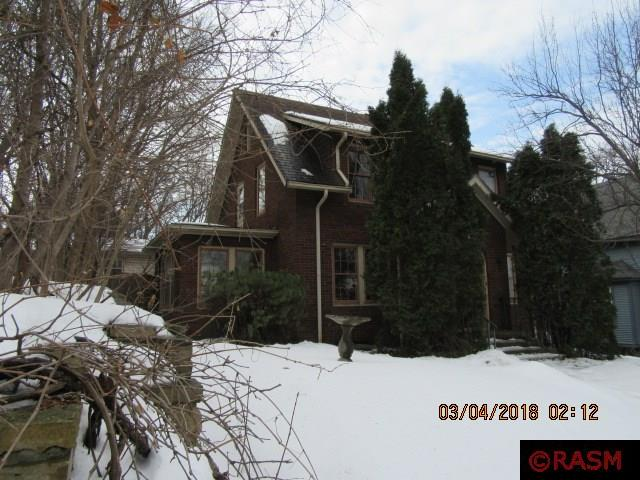 With a little bit of elbow grease this 3 bedroom home could shine. Main level has a 4 seasons sunroom, dining room, kitchen and living room with fire place and hardwood floors. Upper level has 3 bedrooms and a full bath. Basement is unfinished. Tuck under garage and fenced yard.