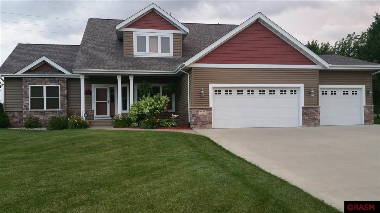 Check out this spacious two-story, 4BD, 3.5 BA home, with a dedicated office, located in the highly desired neighborhood of Coventry Heights in upper North Mankato. Beautiful hardwood floors lead you to the main floor master suite, with vaulted ceilings and a corner fireplace. A commanding 2-story great room takes you to the large kitchen, boasting tons of storage and work-space, with Quartz countertops and center island with raised counter and seating. All new appliances were recently upgraded. The main floor laundry area with a new Speed Queen W/D set and is complimented with a conveniently positioned ½ bath. Upstairs, you will find a peaceful loft space, perfect for use as a reading area and 2 generously sized bedrooms both with walk-in closets. Finishing off the upper level, is a full bath. The recently finished lower level of this home features a large game area and adjacent TV area,   4th bedroom with walk-in closet, ¾ bath, and utility area for plenty of storage. A triple heated garage caps off this home, situated on a peaceful private pond lot with abundant wildlife to enjoy!
