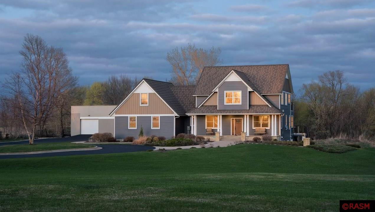 Quiet country estate located at the end of a tree lined cul de sac. Nestled in the lakes region, this 5 bedroom 4 bath Craftsman Style home sits on just over 2 acres with approx. 10,000 sq. feet of living space.  The house offers 5400 sq. feet with the attached commercial grade gymnasium adding another 4800 sq. feet. The main level boasts beautiful Brazilian cherry flooring and a cozy library/office with see thru fireplace to the sunken family room.  Enjoy the open concept kitchen with cherry cabinets and large eat in area. Adjacent to the kitchen is a large mudroom with locker system and a half bath. The upper level offers an open study area with built in desk and shelving, full bath, 4 bedrooms including a master en suite with laundry room and veranda. A secret door leads to bonus space that could be used as a bunk room. In the lower level host friends and family for a wine tasting in the climate-controlled wine cellar, game of pool in the billiards area, a night of movies in the theater space or kick back and relax in the bar area. The three stall garage is heated and insulated with stairs that lead to lower level. There is an additional two stall tandem garage attached to the gym for more storage.  This home offers easy, close access to an abundance of outdoor recreation not to mention it's located only 5 miles to the Mankato Airport. Need reliable internet?  Enjoy $25,000 of fiber optic cable recently installed to work at home.  No detail was overlooked on this impeccably maintained estate!!
