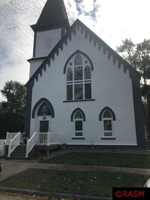 Great investment opportunity!  Side by side duplex that was recently updated in 2017 and a new roof in 2020.  These homes offer the uniqueness of the old historical church, but with modern amenities.  Unit B offers 3 bedrooms and 2 full baths and collects $1125 a month plus utilities, Unit A offers 4 bedrooms 2 full baths and collects $1200.00 a month plus utilities.  Both units are offered basement storage and laundry in the units.  Live in one unit and rent the other, or keep as a total investment property.  Listing Agent is the owner of this property.