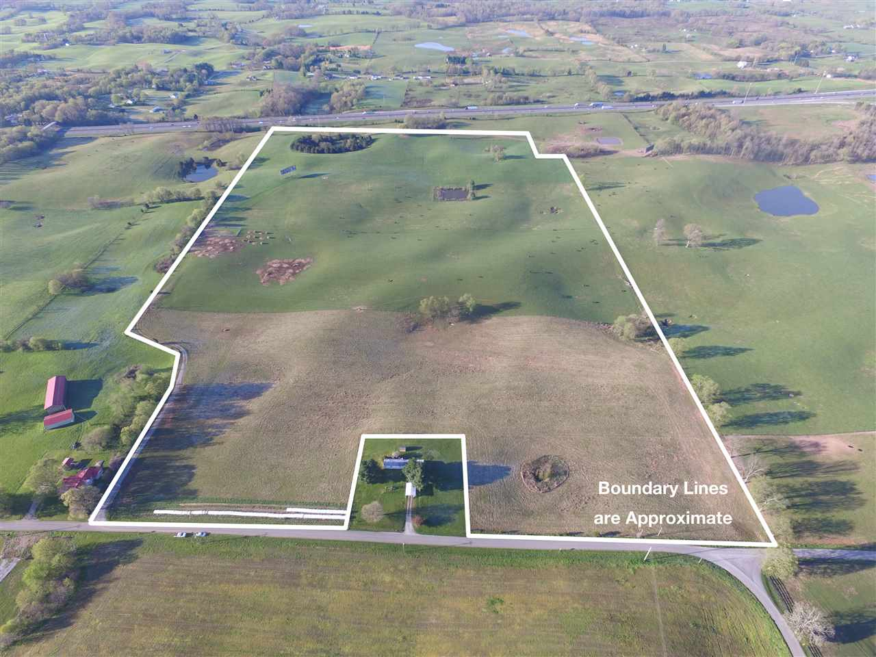 Opportunity, opportunity! 67+/- acres very, very close to the Bowling Green Transpark with beautiful building sites. Great development potential. Currently fenced, cross fenced with waterers, pond, and income from a bill board sign. Convenient to Transpark, I-65  in a very fast growing area.