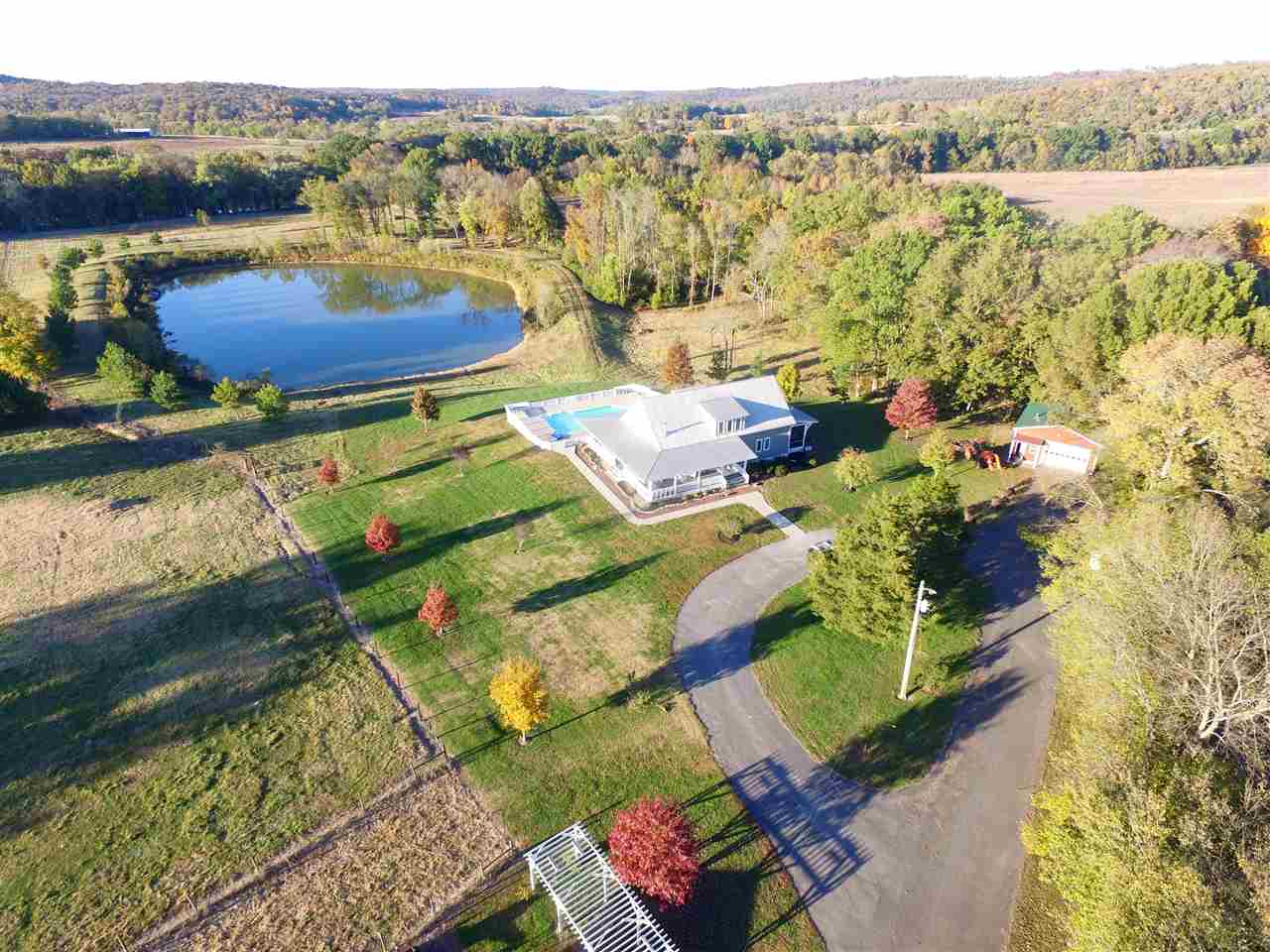 Gorgeous 106 acres with 4 bedroom, 3.5 bath modern home with a full heated and cooled walk out basement, including a huge in ground salt water pool, 3+ acre lake with fish, frontage on Barren River, pastures, run in shed for cattle, fencing, great hunting, very private and secluded yet only 5 - 7 minutes from down town Bowling Green, baseball stadium, WKU, restaurants, Natcher Parkway, shopping. This is a must see property.
