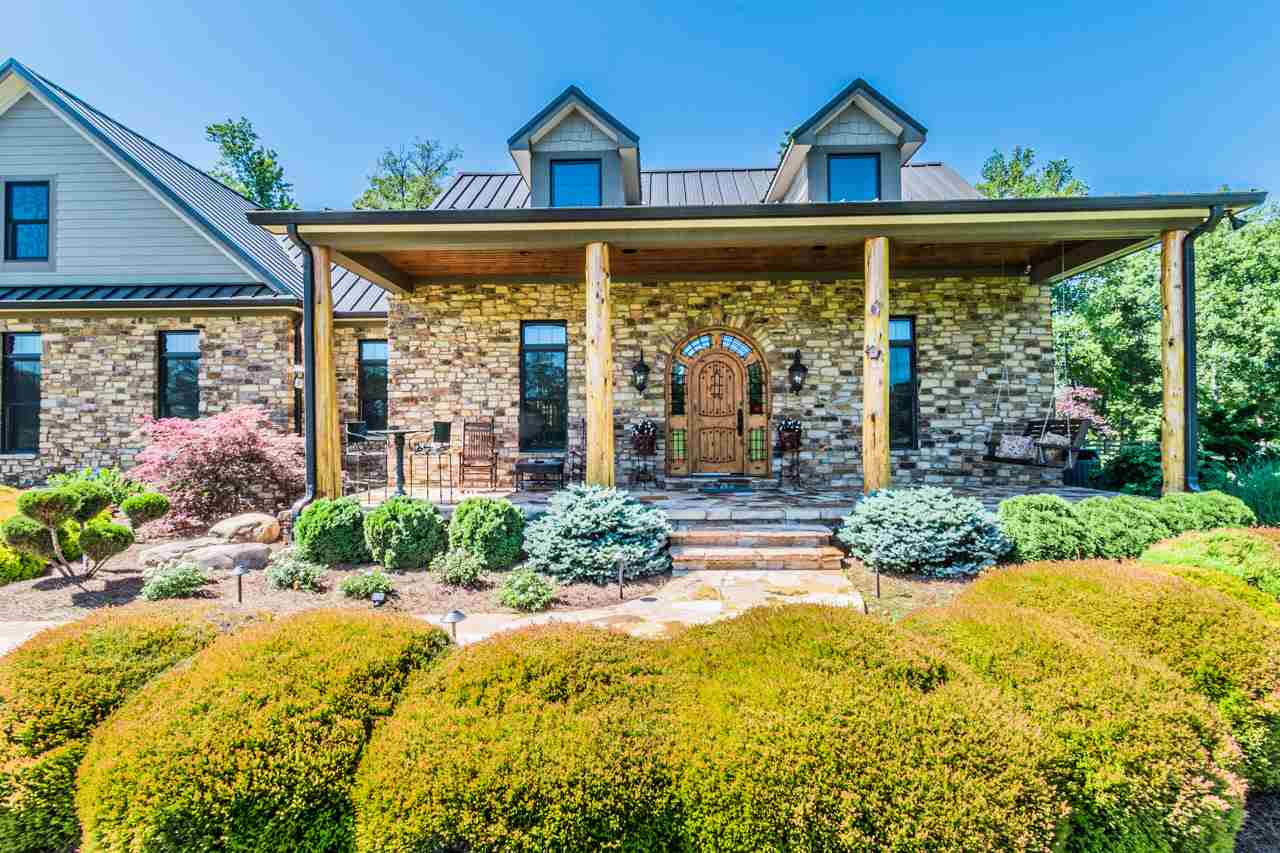 One of a kind gem - this beautifully unique custom built 4 bedroom, 3.5 bath home on 5.33 acres has premium quality features throughout which is evident beginning with the gated stone entrance and lush landscaping. 6+ car garage, 50 kilowatt back up generator, standing seam metal roof, solid knotty Alder wood doors, irrigation system, Arkansas stone, flagstone walks, porch and outdoor living space complete with outdoor stone fireplace, 8 camera security system, 42.5 x 19 bonus room and the list goes on.